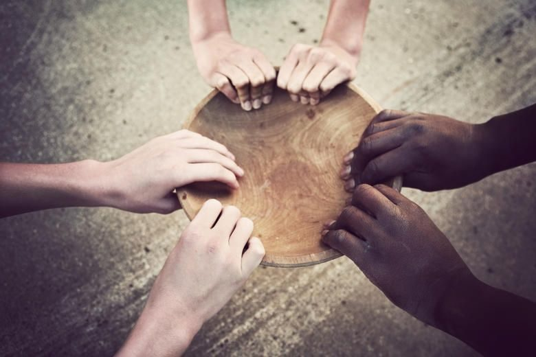Hands-Holding-Wooden-